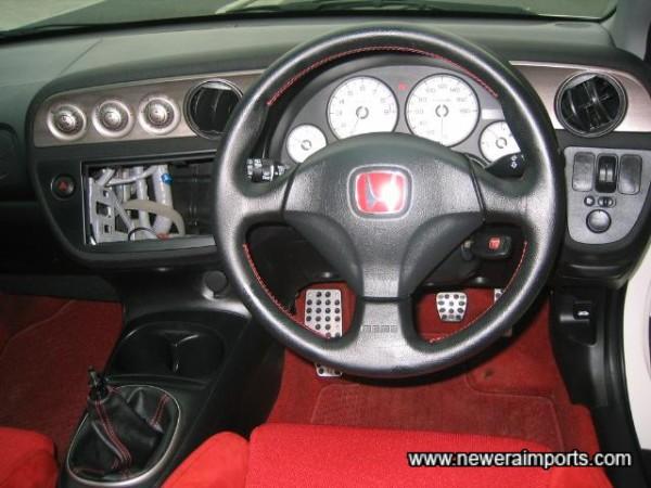MOMO leather rimmed SRS steering wheel.