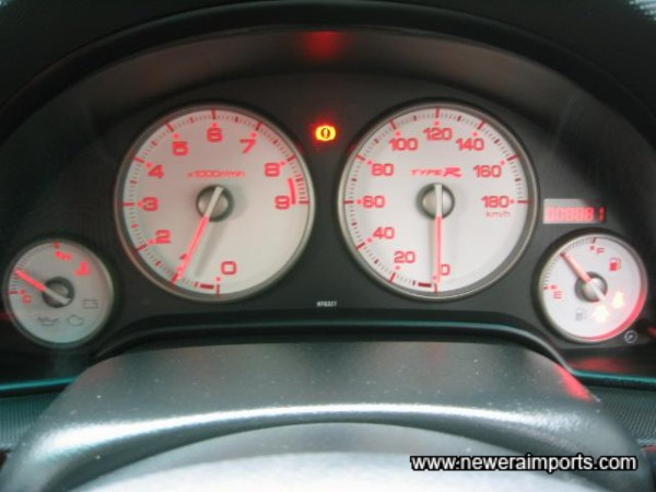 Facelift model has white faced backlit gauges.