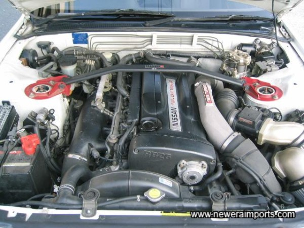 Engine bay is particularly tidy on this example.