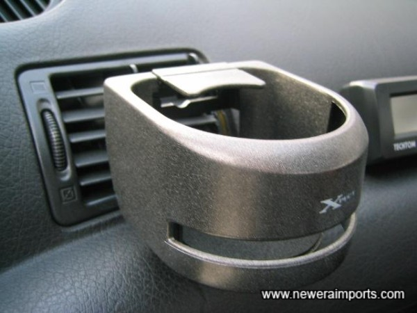 Drink holder - cools drinks with A/C in summer.