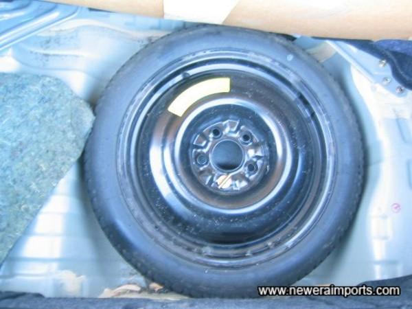 Original spare wheel and tool kit are unused.