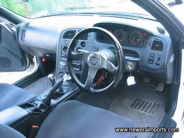 Momo ''Race'' steering wheel has replaced original.