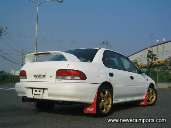 Red Subaru rally mudflaps fitted.