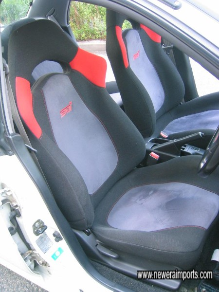 Driver`s seat unmarked and cushioning still firm and as new.