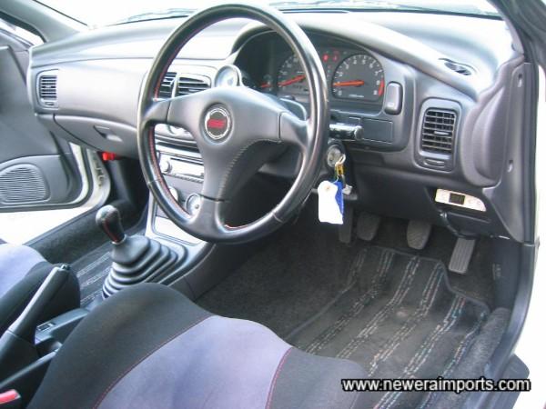Steering wheel is unmarked.