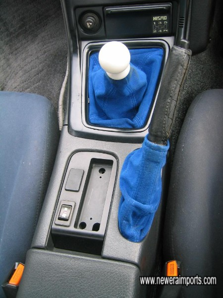 Gear knob is now hidden behind passenger front carpet, for safety against pilferage in shipping.