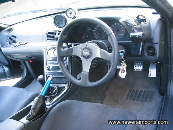 Momo 'race' steering wheel is fitted.