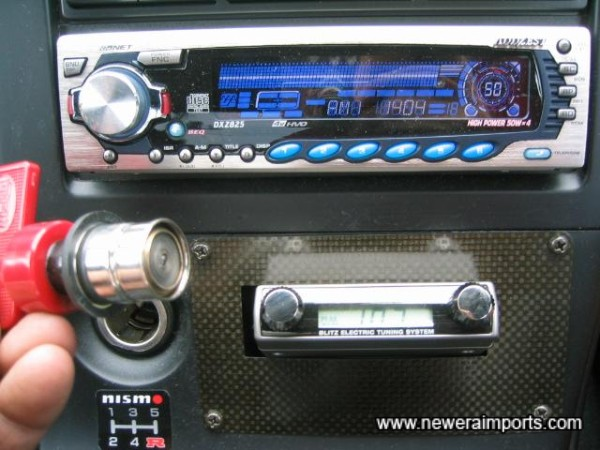 Nismo cigar lighter fitted.