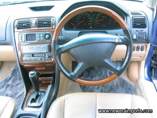 Wood / leather rimmed Nardi SRS Air bag steering wheel.