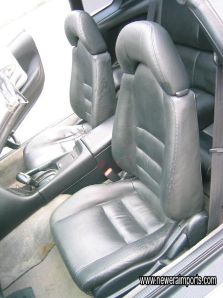 Leather's in excellent original condition throughout - note coffe / drink spillage will be cleaned off.