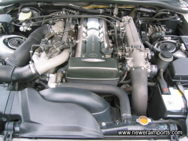 Engine bay in tidy condition.