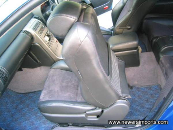 Seats glide forward electrically to allow easy access to the rear seats.