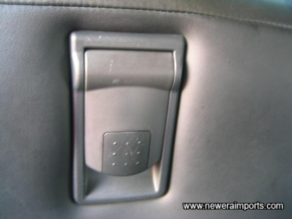 Rear seat occupants can put this handle at the top of the front passenger seat - and it will fold and glide forwards automatically.