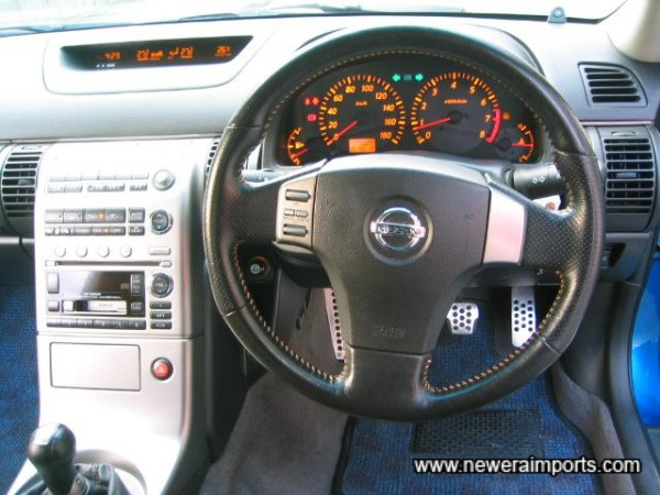 SRS leather rimmed steering wheel with remote controls for BOSE hifi system.