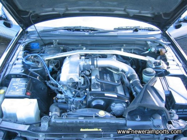 Engine bay clean & well kept.