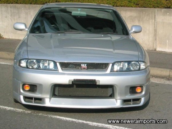 Xenon lights and deeper front splitter gives this GT-R a much more modern stance.