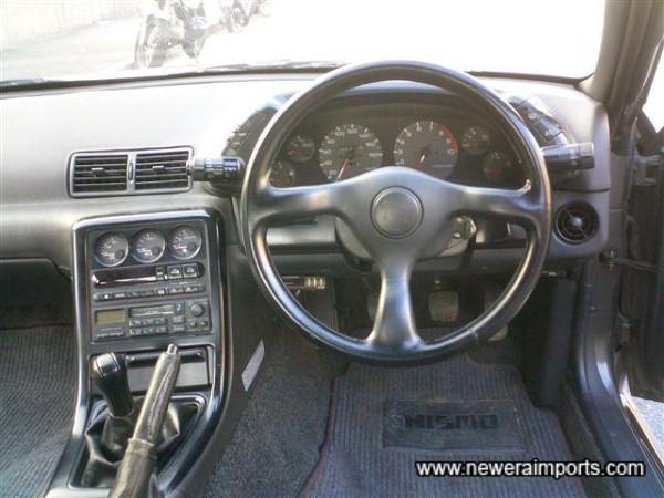 Note unworn original steering wheel and gear knob. Another sign of genuine mileage.
