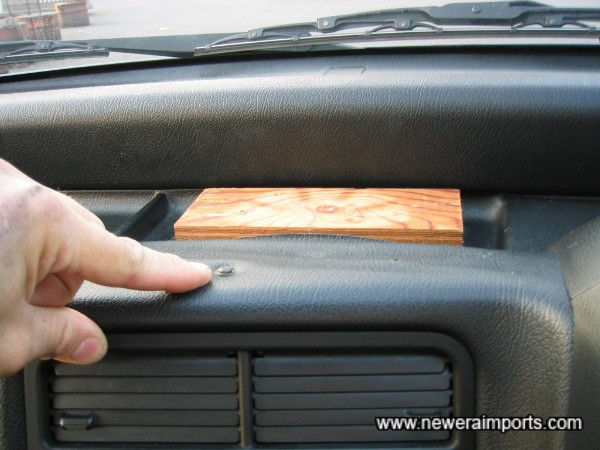 Screw on centre of dash - Wood is stuck onto dash (Removable).