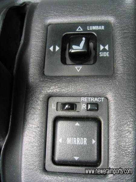 Driver's seat adjustment & mirror controls.