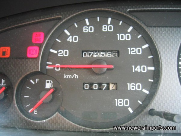 Original odometer reading shows kms before recalibration to miles in the UK.