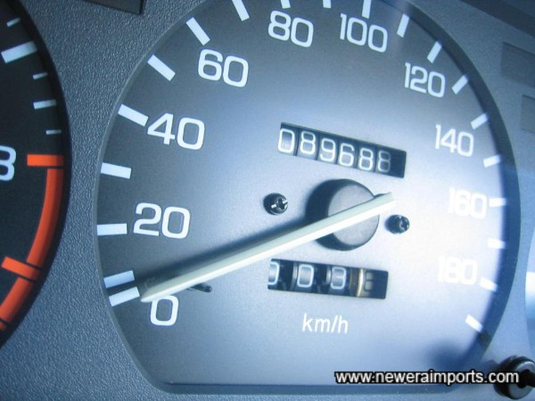 Warranted mileage shown in kms, before conversion to miles in UK.