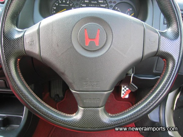 Steering wheel by Momo. Has SRS airbag and no wear.