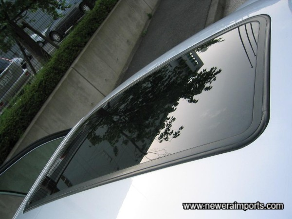 Electric glass sunroof (Tinted - with interior slidable cover).