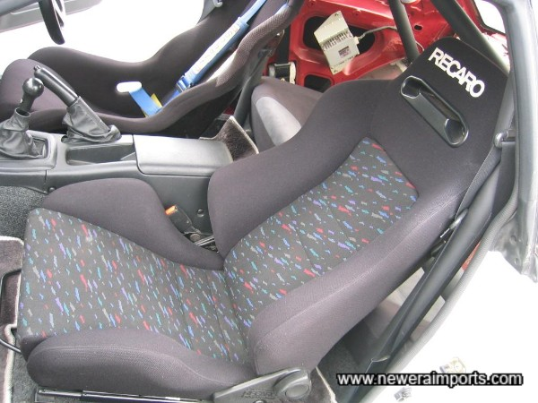 Recaro reclinable seat for passenger, but bolstered enough to give support at high speeds.