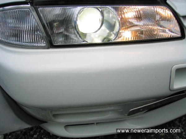 High beam on - gives HID main and normal bulb high beam.