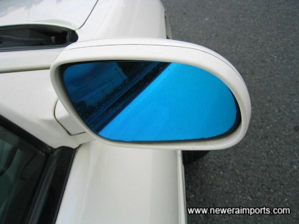 Blue tint on door mirror glass.