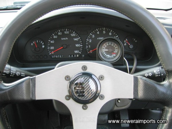 Momo Steering Wheel - Note, unmarked original wheel is in the boot also.