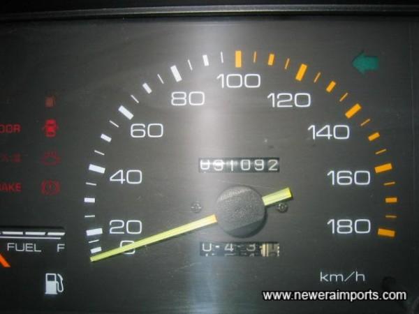 Original odometer mileage shown in km - before recalibration to miles in UK