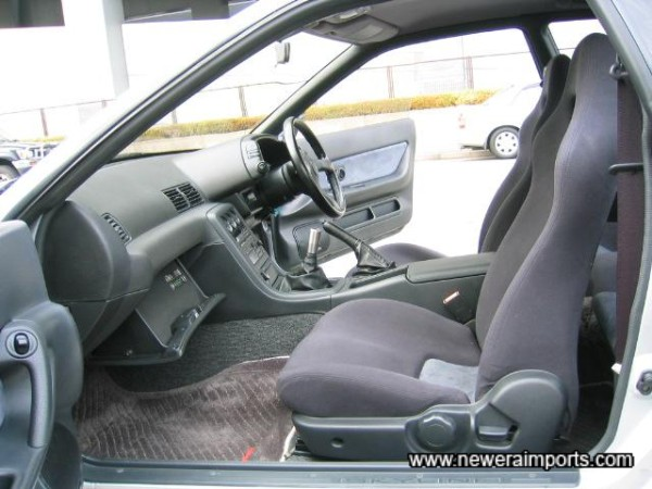 Interior is unmarked and in near new condition in keeping with low genuine mileage.
