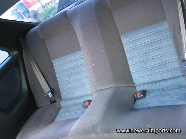 Rear seats are similarly unmarked.