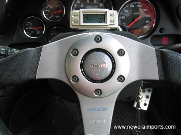 Momo Race steering wheel is in excellent unworn condition.
