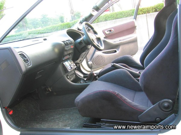 Interior is unmarked and has low wear in keeping with low genuine mileage.
