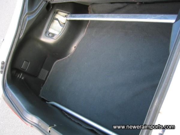 Covers are missing in the boot trim, to enable the strut brace to be fitted and allow access to adjust damping. Replacement covers are available from Honda inexpensively if required.