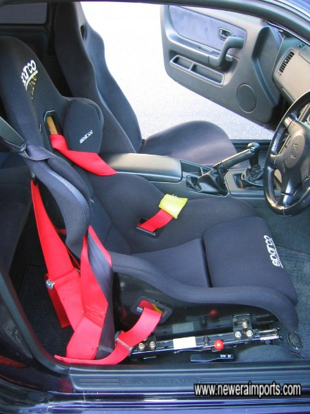 Sparco Race seat with full harness (Original driver's seat can be obtained, or we have a Recaro reclinable FIA approved seat that can be substituted.