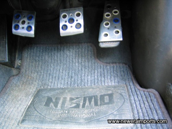 Nismo mats and alloy pedal covers.
