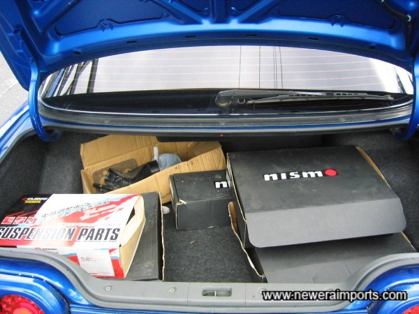 Original suspension arm components are in the boot.