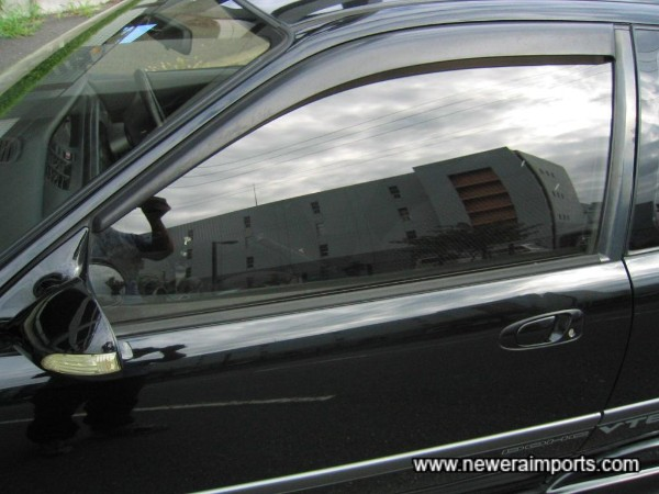 Original option wind deflectors are fitted.