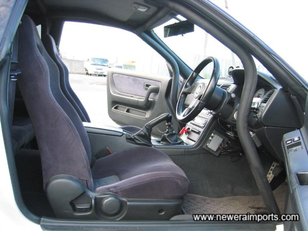 Cusco 6 point safety 21 roll cage - neatly & professionally clothed in black foam.