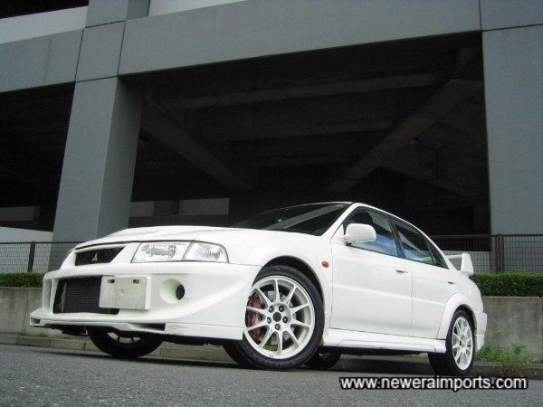 Looks awesome in white - with white matching Enkei's!