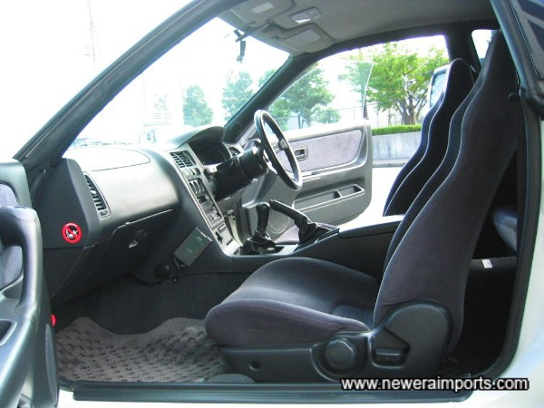 Interior is in excellent unworn condition in keeping with low genuine miles.
