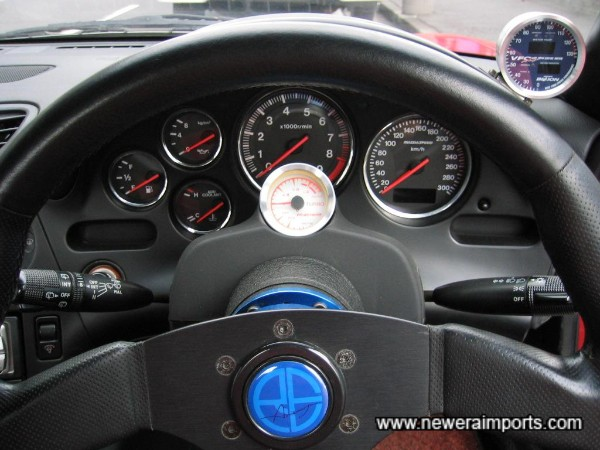 RE-Amemiya steering wheel and annodised alloy boss extension.