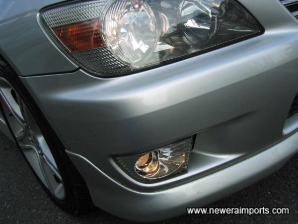 Driving lights integrated into the front bumper.