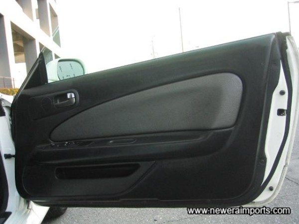 Driver's door panel has a small nick on the top corner,
