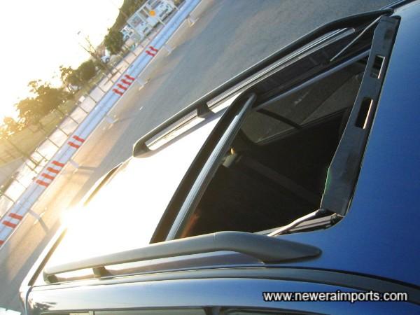 Original option electric Glass Sunroof & Roof Rails.