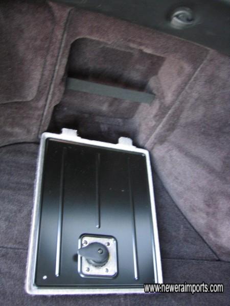Small storage compartment in boot area.