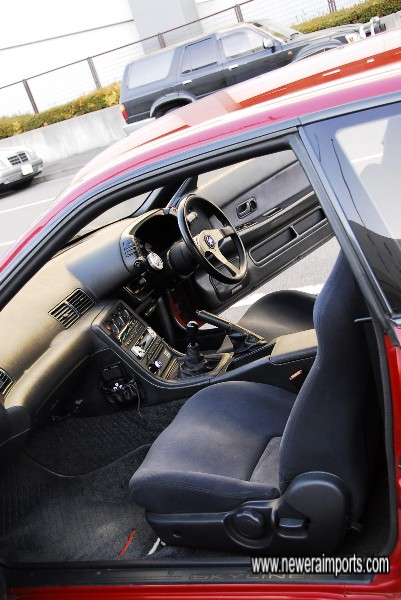 Interior's in excellent unworn condition in keeping with the low genuine mileage of this car.